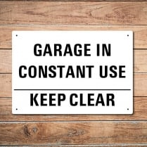 Garage In Use Metal Sign