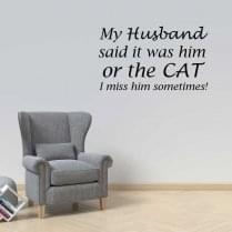 My husband said it was him or the cat wall sticker